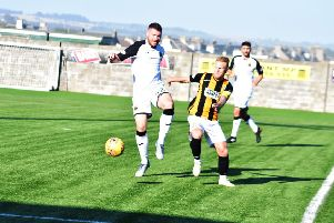 Scott Agnew challeneges for the ball during the 2-2 draw against Dumbarton (Pics by Kenny Mackay)