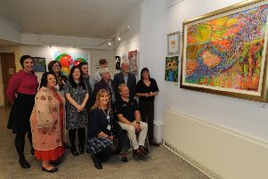 Winners, guests and judges look at one of the entries on show at'Lochgelly Centre.  Pic: Dave Wardle