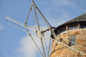 The damage to the windmill's sails.