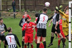 United clear their lines at the weekend. Pic by Graham Strachan.