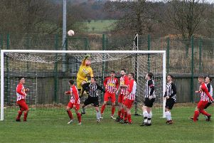 Stoneyburn  force pressure on the Newburgh  goal. Pic by Graham Strachan.