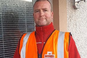 Postman Darren McLeod who helped save the life of a seriously ill man.