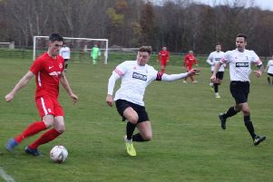 Tayport (in white) were beaten 5-0 by Carnoustie Panmure on Saturday. Pic by Carnoustie.