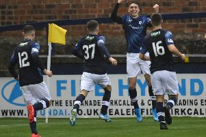 Raith Rovers striker Kieron Bowie celebrates his third minute header which proved to be the winner against Peterhead. Pic: Duncan Brown