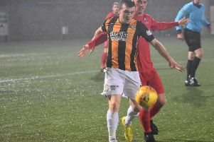 Liam Watt is held up as the Fifers go on the attack. Pic by Kenny Mackay.