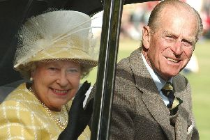 Braemar Gathering 2003 - the Queen and Prince Phillip wave to the crowds (Pic: Bill Dickman, Fife Free Press)