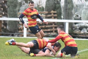 Sam Rowlands slides in for the first of Howe's two tries. Pic by Chris Reekie.