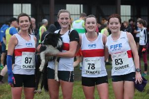 The winning Fife AC women's team and team mate who won the senior women's title, Annabel Simpson (right).