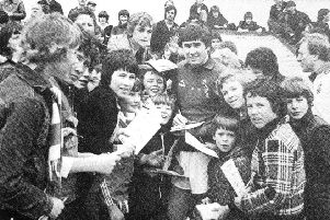 Murray McDermott surrounded by supporters on his testimonial day.