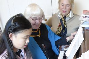 Zimeng with piano teacher Sister Avril and trustee Maggie Picken.
