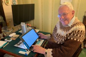 Jim Thompson (95) with his Optelec Traveller HD video magnifier