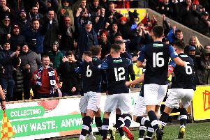 Raith players celebrate John Baird's opener with the fans.