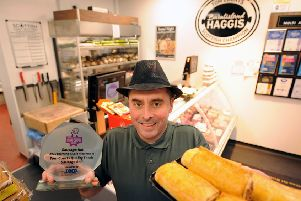 Burntisland butcher Tom Courts with his accolade and his award winning sausage rolls. Pic: Fife Photo Agency.