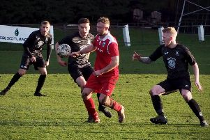 The Leith midfield are crowded out by Saints. Pic by Blair Smith.