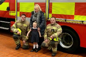 Hollie Aitken and mum Siobhan Mullen with firefighters at Lochgelly Community Fire Station.