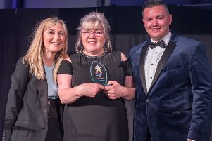Jeannie McLeman receives her honour from awards host Fiona Phillips