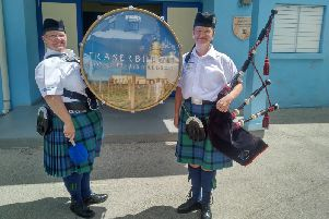 Louise Buchan and pipe major Denise Buchan.
