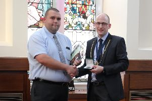 Shaun Craig receives his award from Kevin Bowie, Deacon of the Wrights and Coopers