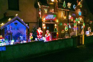 The couple's house has been transformed into a festive treat to raise funds for the local primary school.