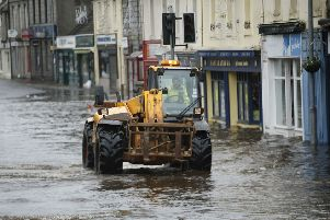 A vehicle is driven through flood water in Newton Stewart yesterday. Picture: Danny Lawson/PA
