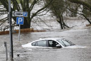 A car left abandoned in flood water in Newton Stewart yesterday. Picture: Danny Lawson/PA