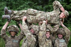 Soldiers and dancers lift Harriet from 5 Soldiers.