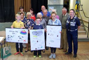 The pupils are pictured with their designs at the community council meeting.