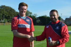 Newton Stewart's Craig Wilsons Ltd Man of the Match was James McMiken, pictured with coach Martin Wallace