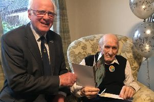Drew Learmouth accepts his birthday card from the Queen from Vice Lord Lieutenant Sandy McCulloch