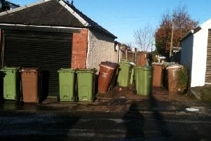 Netherlee residents are angry over being forced to leave bins on the street.