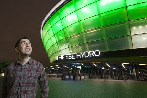 Face of the campaign...Scottish transplant recipient Gordon Hutchinson visited the illuminated SSE Hydro in a bid to  encourage people across Scotland to join the NHS Organ Donor Register.