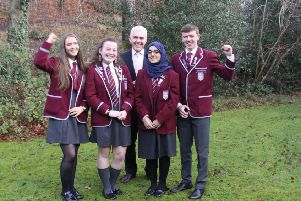 Emma Martin, Caitlyn Martin, Amina Hussain and Alexander MacDonald with St Ninian's High School headteacher John Docherty.