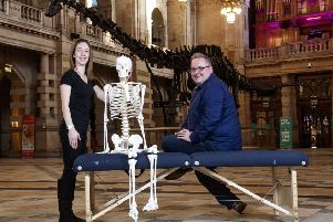 Derek Leitch, owner, and Laura Sutherland, chiropractor at Clarkston Chiropractic, with Dippy at Kelvingrove Museum. Photo: Gary Hutchison.