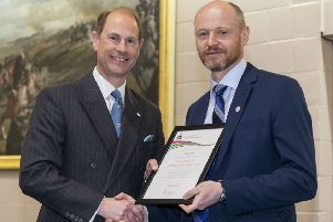 Tom receives long service award from Prince Edward