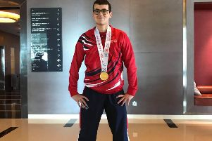 Samuel Scott is pictured with the gold medal he won for skippering GB to success at Special Olympics