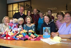 Kniiting for All, back row, Dr Ken Cunningham, chairman of Children 1st; Helen Howard, Knitting For All Tutor; and Costa 'Clarkston staff; front row, members of Helen's Knitting For All: Clarkston & Giffnock class.