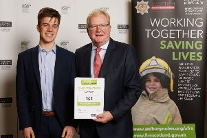 Jackson Carlaw MSP and Netherlee resident, Jonny Connelly pictured collecting the certificate on behalf of Eastwood.