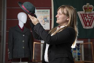 Jennifer Hunt, Archivist, Royal Voluntary Service Heritage Collection with a 1940s WVS hat (Photo: Martin Shields)
