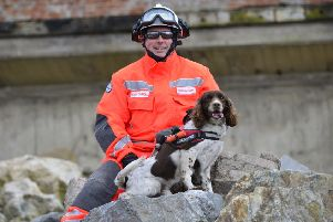 'Animal of the Year' Diesel with handler Crew Commander Cary Carroll.