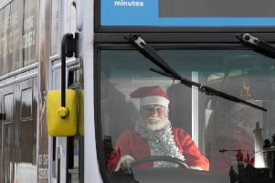 First Glasgow Santa Michael Coll gets behind the wheel