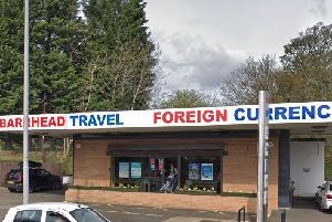 Man arrested over armed raid at Barrhead Travel in Newton Mearns