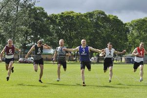 Greg Turnbull  wins this year's 110m sprint at Peebles.
