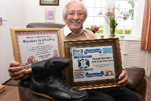 Ex-wrestler Tommy Stevenson with his old wrestling boots reflects on his career in the sport.