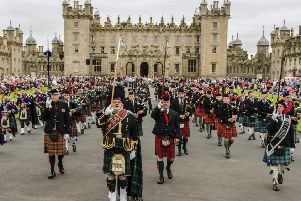 The massed pipes and drums perform.
