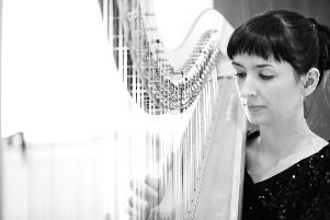 Harpist, Gwen Sinclair, one half of BabaYaga.