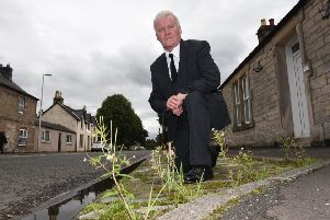 Hawick and Hermitage councillor Davie Paterson in Newcastleton's North Hermitage Street.