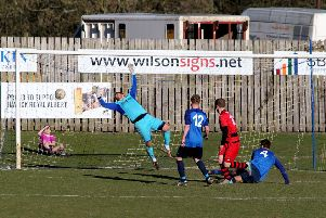 Hawick keeper Craig Saunders makes a save from Graeme McGregor East Stirling.