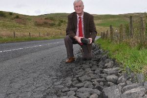 Hawick and Hermitage councillor Davie Paterson surveying the state of the B6399 to Newcastleton from Hawick.