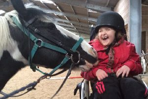 Mia Russell enjoys a visit to the Borders RDA centre at Monteviot.