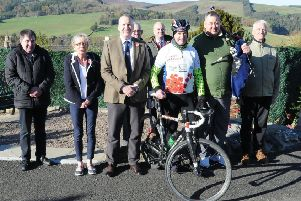 Hawick RBLS branch chairman Ian McLeod with David Deacon, piper Kev Turnbull  and supporters from both Hawick and Selkirk at Selkirk war memorial during his 1,918 cycle.